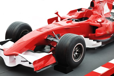 car race track: formel 1 one auto fast red  car isolated on white background in studio representing power and speed concept Stock Photo