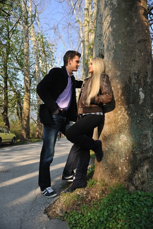 happy young romantic couple in love dance outdoor at spring season on early mornig with beautiful light photo
