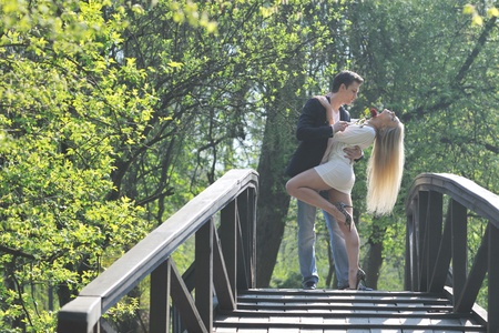 couples outdoors: happy young romantic couple in love dance outdoor at spring season on early mornig with beautiful light