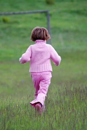 girl running in nature  photo