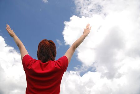 girl with arms wide open and sky background (Multiple values) photo
