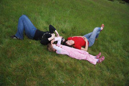girls seat on grass   photo