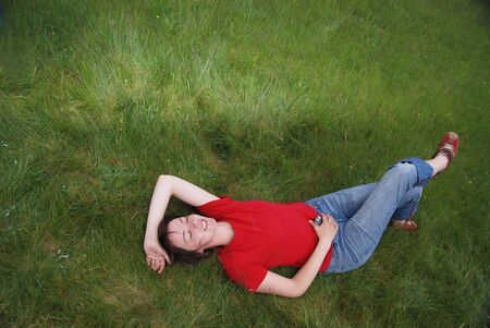 woman laying in grass   photo