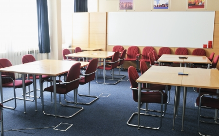 video conference room with chairs and big board  projector canvas and computer photo