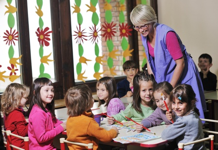 happy child kids group have fun and play at kindergarden indoor preschool education concept with  teacher Stock Photo - 11422962