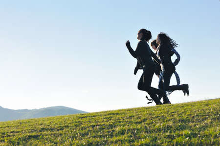 group of teen people woman  have fun outdoor with blue sky in background photo