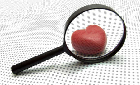 finding love: magnifying glass Stock Photo