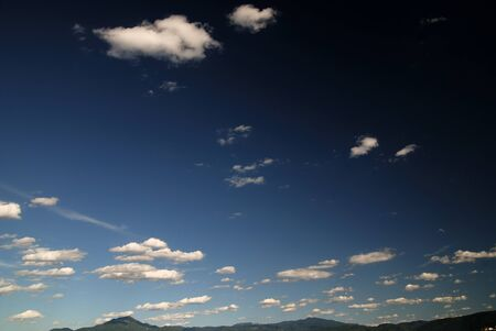 pall: blue sky with dramatic clouds