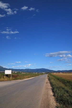 hiway: long country road with dramatic sky
