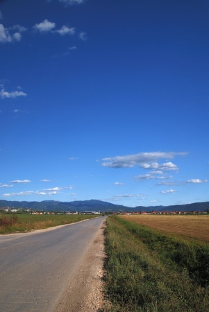 long country road with dramatic sky  photo