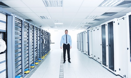 young handsome business man  engeneer in datacenter server room Stock Photo - 11465770