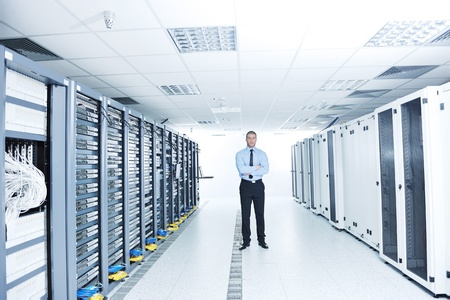 young handsome business man  engeneer in datacenter server room Stock Photo - 11465811