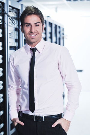 young handsome business man  engeneer in datacenter server room Stock Photo - 11465807