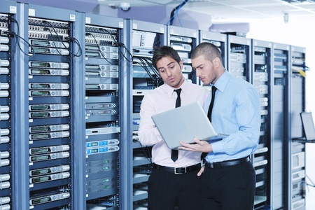 group of young business people it engineer in network server room solving problems and give help and support Stock Photo - 11399121