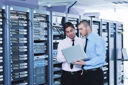 group of young business people it engineer in network server room solving problems and give help and support Stock Photo - 11399120