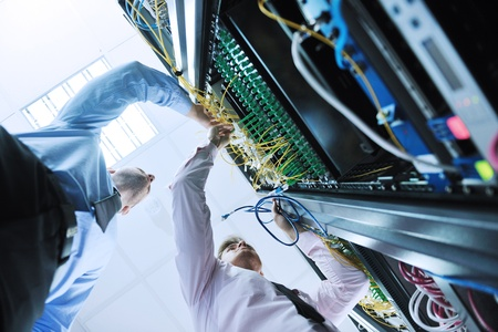 group of young business people it engineer in network server room solving problems and give help and support Stock Photo - 11448759
