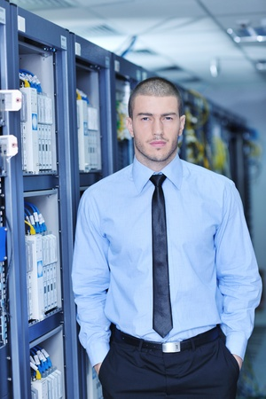 young handsome business man  engeneer in datacenter server room Stock Photo - 11448829