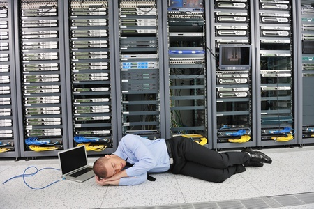 it business man in network server room have problems and looking for  disaster situation  solution Stock Photo - 11399109