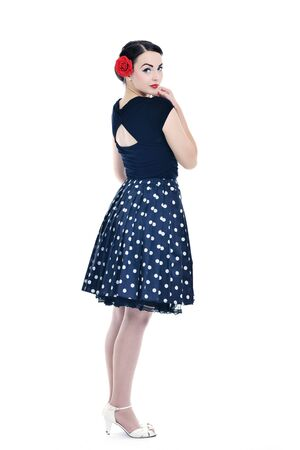 brunett: beautiful young woman isolated on white in studio in old fashion clothes representing pinup and retro style