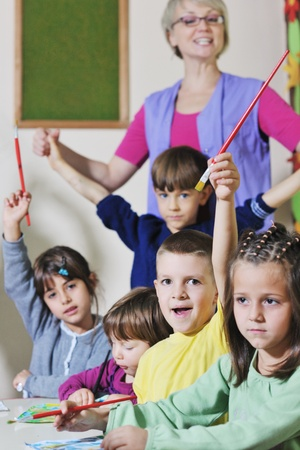 happy child kids group have fun and play at kindergarden indoor preschool education concept with  teacher Stock Photo - 11718236