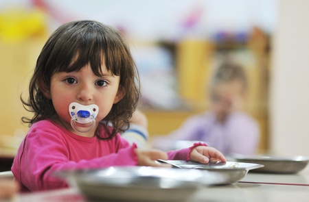 happy child kids group have fun and play at kindergarden indoor preschool education concept with  teacher Stock Photo - 11717557