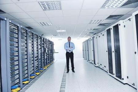datacenter: young handsome business man  engeneer in datacenter server room