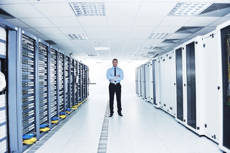 provider: young engeneer in datacenter server room Stock Photo