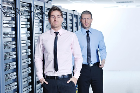 group of young business people it engineer in network server room solving problems and give help and support Stock Photo - 11718242