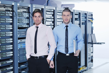 it support: group of young business people it engineer in network server room solving problems and give help and support