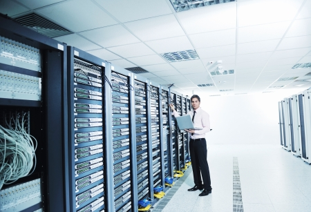 providers: young handsome business man  engeneer in datacenter server room