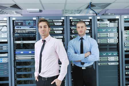 group of young business people it engineer in network server room solving problems and give help and support Stock Photo - 11718243