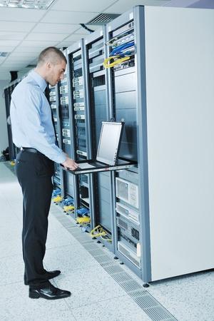 data center data centre: young handsome business man  engeneer in datacenter server room