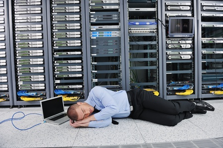 disaster recovery: it business man in network server room have problems and looking for  disaster situation  solution