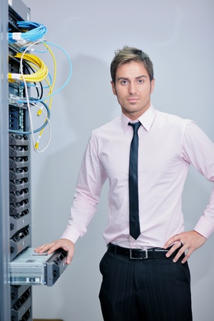 young handsome business man  engeneer in datacenter server room Stock Photo - 11873062