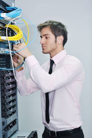 young handsome business man  engeneer in datacenter server room Stock Photo - 11873108