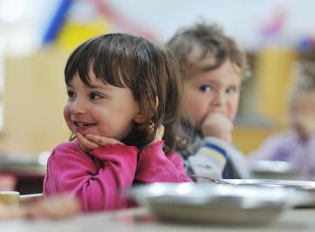 children happy: happy child kids group have fun and play at kindergarden indoor preschool education concept with  teacher