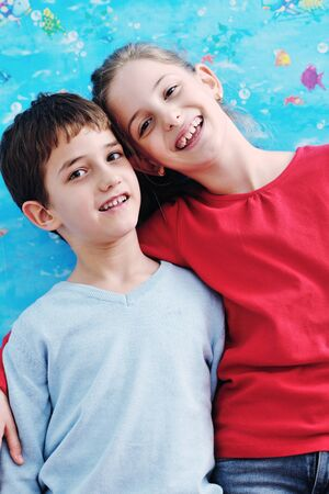happy child kids portrait at home brother and sister hug and have fun and joy photo