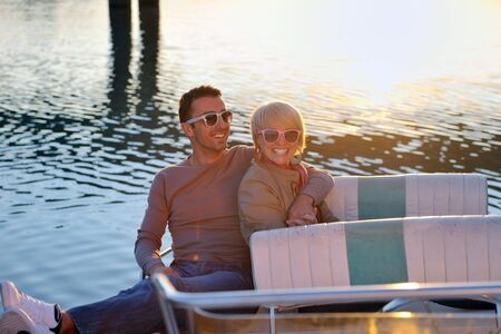 happy young couple in love  have romantic time at summer sunset   at ship boat while  representing urban and countryside fashin lifestyle Stock Photo - 12069617