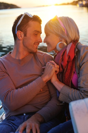 happy young couple in love  have romantic time at summer sunset   at ship boat while  representing urban and countryside fashin lifestyle Stock Photo - 12058266