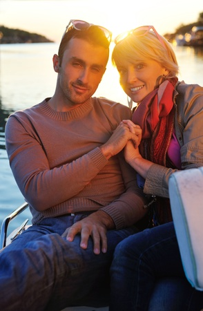 happy young couple in love  have romantic time at summer sunset   at ship boat while  representing urban and countryside fashin lifestyle Stock Photo - 12069626