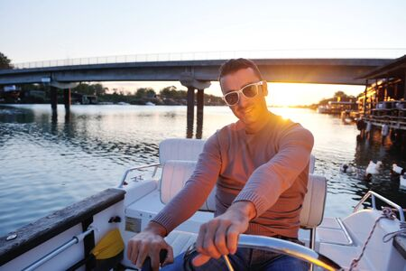 happy young man have fun at boat at sunset on summer season Stock Photo - 12070166