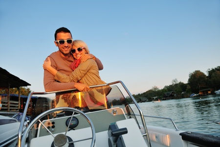 happy young couple in love  have romantic time at summer sunset   at ship boat while  representing urban and countryside fashin lifestyle Stock Photo - 12069625
