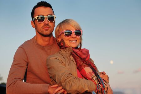 happy young couple in love  have romantic time at summer sunset   at ship boat while  representing urban and countryside fashin lifestyle Stock Photo - 12069677