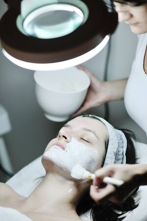 Young beautiful woman receiving cosmetic facial mask in spa beauty salon and relax Stock Photo - 12124204