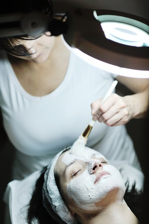 Young beautiful woman receiving cosmetic facial mask in spa beauty salon and relax Stock Photo - 12124276