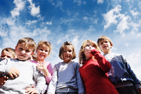 kid portrait: happy child kids group have fun and play at kindergarden preschool education concept with  teacher