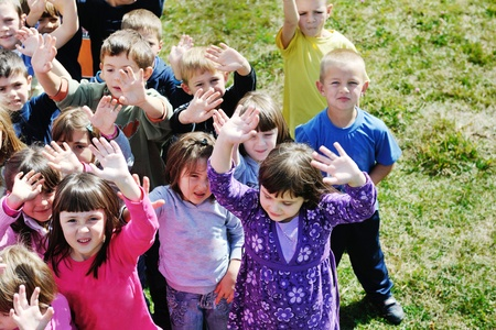 preschool education: happy child kids group have fun and play at kindergarden preschool education concept with  teacher