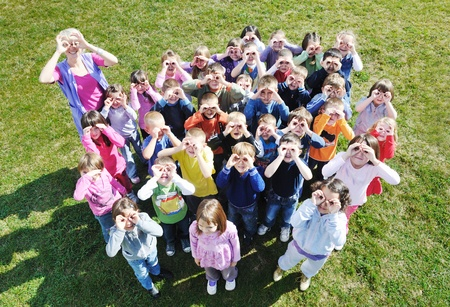 happy child kids group have fun and play at kindergarden outdoor preschool education concept with  teacher Stock Photo - 12303739