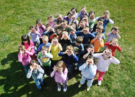 preschool education: happy child kids group have fun and play at kindergarden outdoor preschool education concept with  teacher Stock Photo