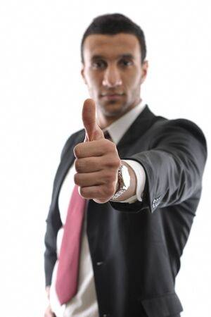 Portrait of a young business man showing thumb up concept photo